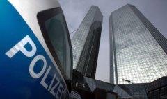 A police car stands in front of the Deutsche Bank headquarters in Frankfurt