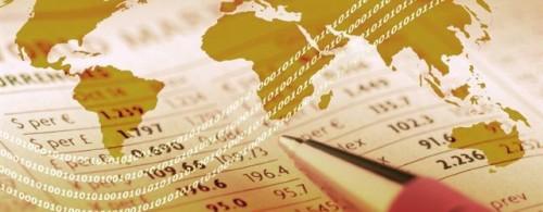 World outline map overlaid on finacial newspaper.