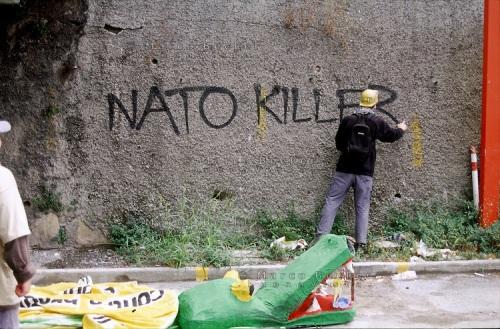 """genova luglio 2001, proteste contro il g8. scritta sul muro: """"nato killer"""" --- genoa july 2001, protests against g8 summit. writing on the wall """"nato killer"""""""
