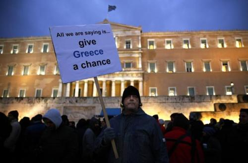 A man takes part in a anti-austerity pro-government demo in front of the parliament in Athens February 11, 2015. REUTERS/Yannis Behrakis